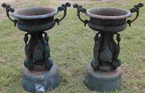 Pair of Victorian cast iron garden urns, 35 in. T.