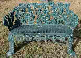 Old cast iron garden bench in leaf pattern