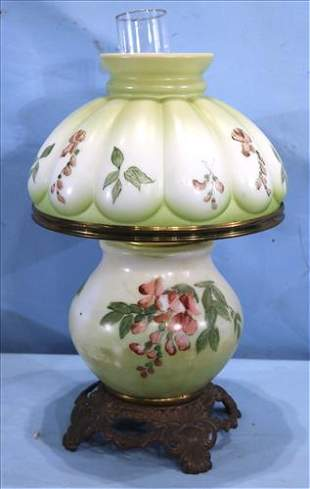 Old oil lamp with green flowers, matching shade
