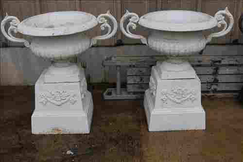 Matched pair of double handle urns on stand, white