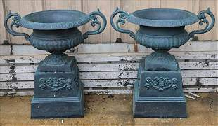 Matched pair of double handle urns on stand, green
