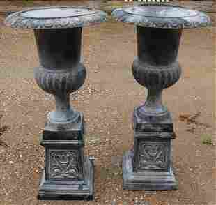 Matched pair of cast iron garden unns on stand, grey