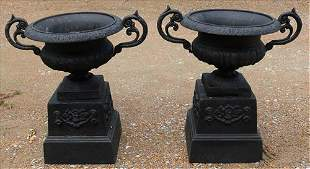 Matched pair of double handle urns on stand, black