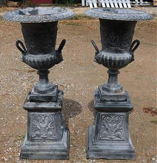 Matched pair of double handle urns on stand, grey