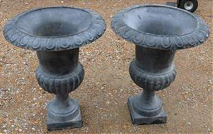 Matched pair of cast iron urns, grey with no stand
