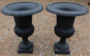Matched pair of cast iron urns, black with no stand