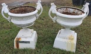 Pair of Victorian cast iron garden urns, 34 in. T.