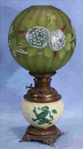 Old oil lamp with lion and green painted shade