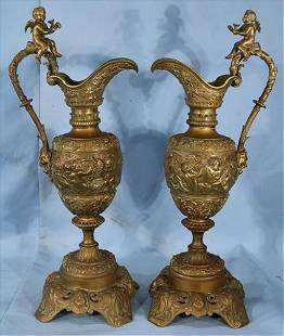 Pair of Victorian bronze ewers with cupids, 25 in. T.