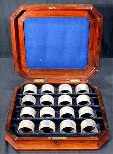 12 silver-plate napkin rings in rosewood box