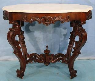 Walnut rococo oval carved center parlor table