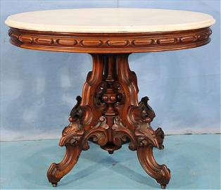 Walnut Victorian oval center table by T. Brooks