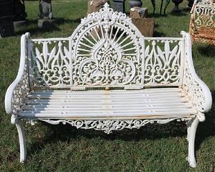 White ornate cast iron bench, loveseat size