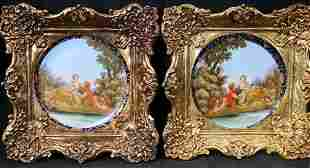 2 hand painted plates in gold gilded frames