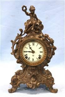 Metal figural Ansonia clock, runs, 12 in. T.