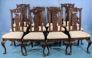 12 Horner heavily carved oak dining chairs