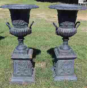 Pair of cast iron garden urns on base , 41 in. T.