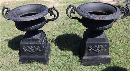 Pair 2 piece cast iron garden urns on base, 27 in. T.
