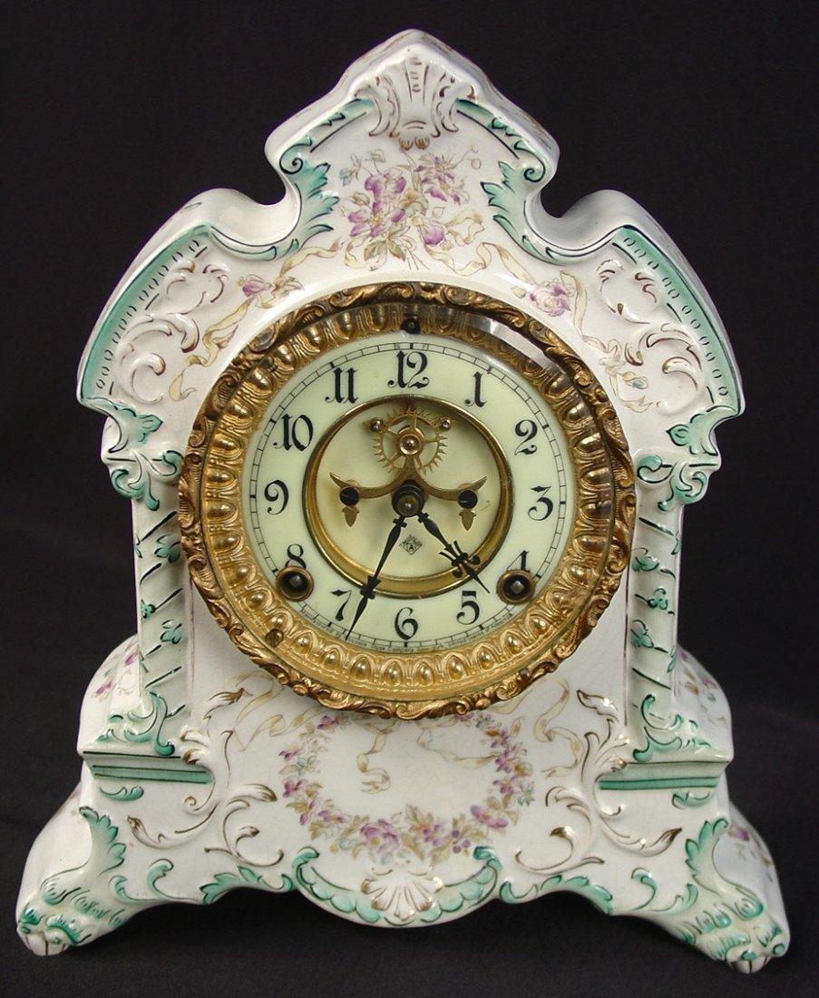 16: Ansonia China Clock, Comanche, 12in. T, 11in. W, go