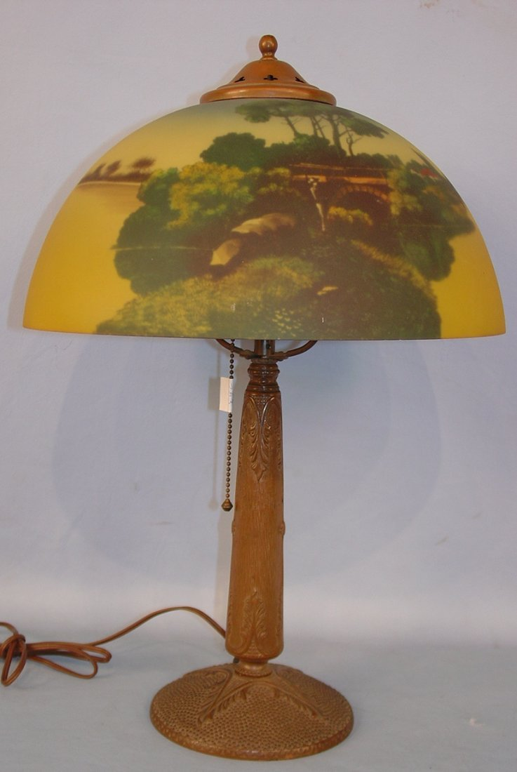 Metal Base Lamp with reverse painted glass shade, lake