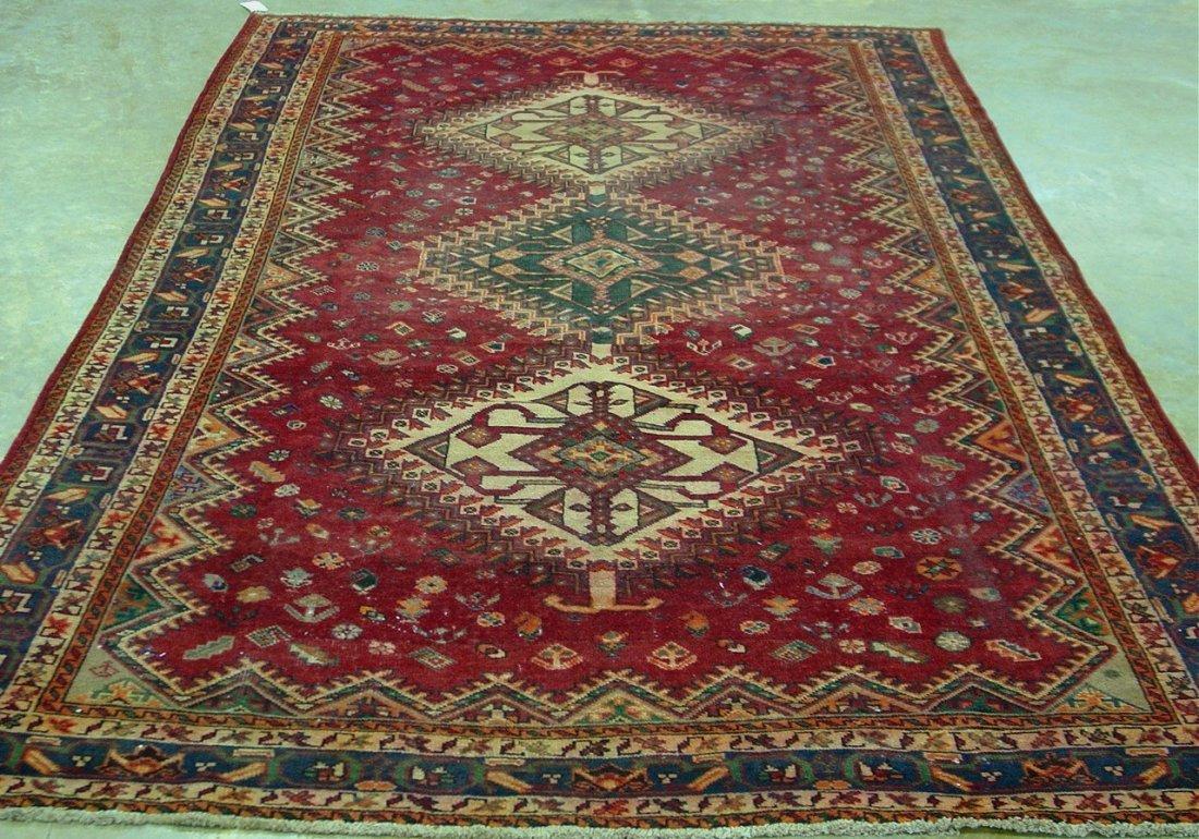 10: Hand made Persian rug, maroon, green, orange and