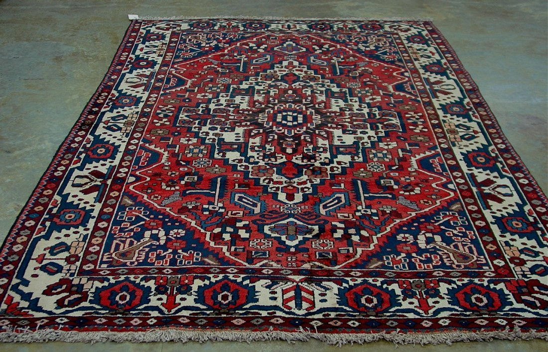 685: Hand made Persian rug made in Iran, brown, blue