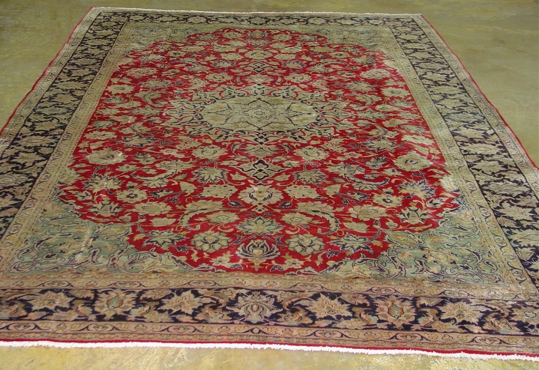 18: Hand made persian rug, 8ft 7in x 12ft 4in. -