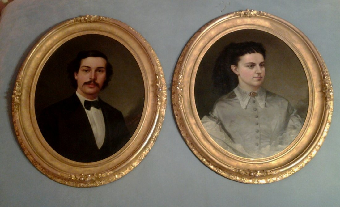 651: Oil on canvas portraits of man and woman in oval