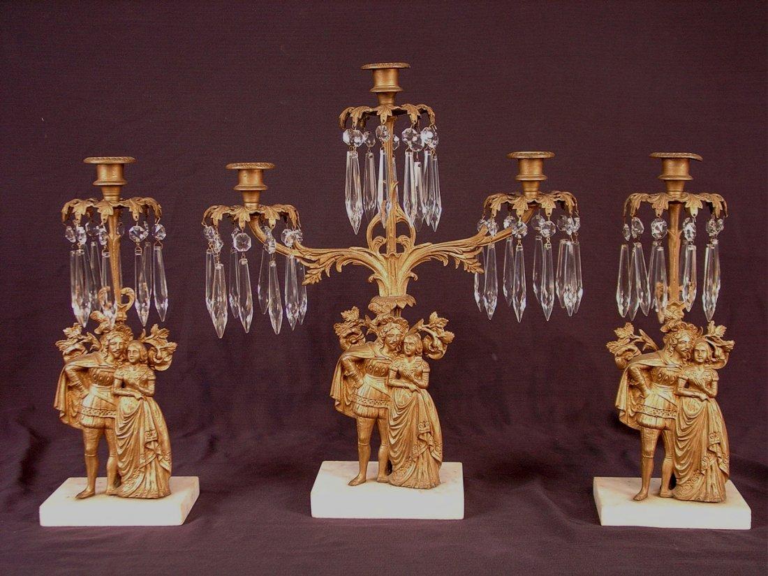 408: Three piece girandoles set on marble base.