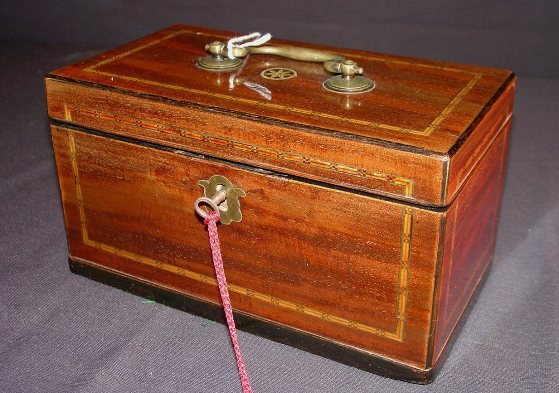 240: Mahogany English tea caddy with metal canisters,