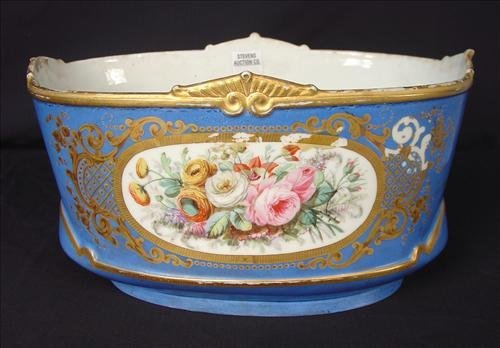 Sevres center bowl, blue with roses and applied gold.