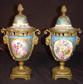 Pair Of Sevres Mantle Urns, Capped With Bronze