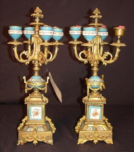 Pair of candelabras, bronze with bronze plaque