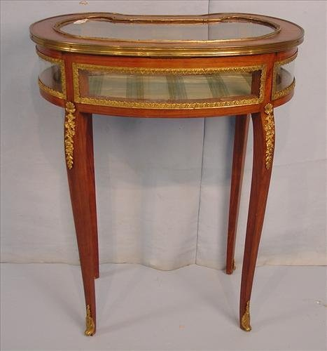 French display case table, kidney shaped with bronze