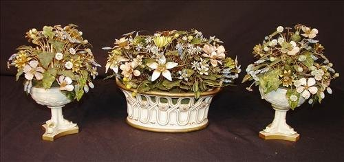 Porcelain and brass painted flowers, at least 75 years