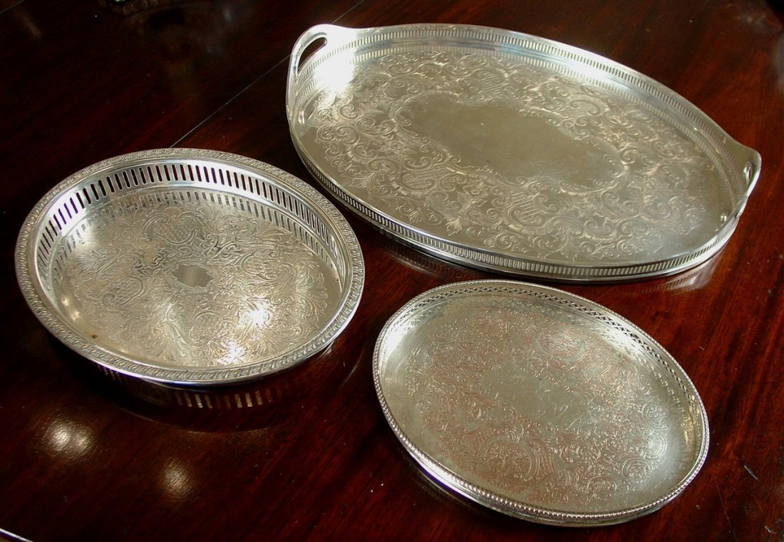 Three piece set of silver-plate gallery trays, 17in  L,