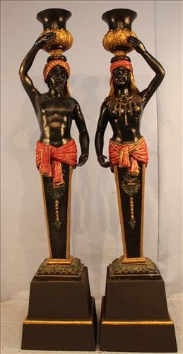 Matched pair of bronze and iron blackamoors