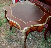 Mahogany French inlay center table with bronze trim.