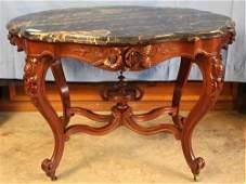 Ornate walnut Victorian turtle top table