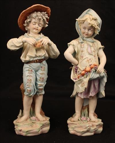 Pair of porcelain figurines with cross swords