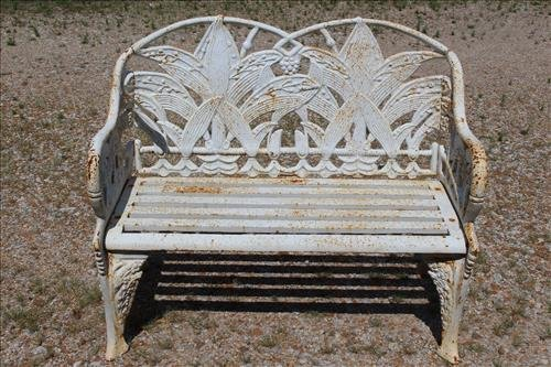 White case iron garden love seat with fern leaves