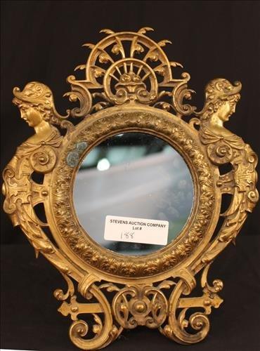 Very fine brass dresser mirror with ladies