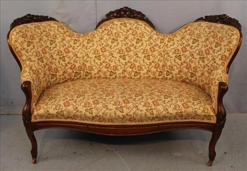 Walnut Victorian loveseat with floral upholstery