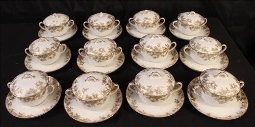 24 piece set Limoges bowls with under plate