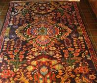 Handmade wool Persian rug with dark red and blue