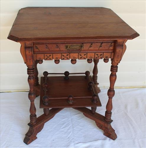 Eastlake walnut center table with drawer
