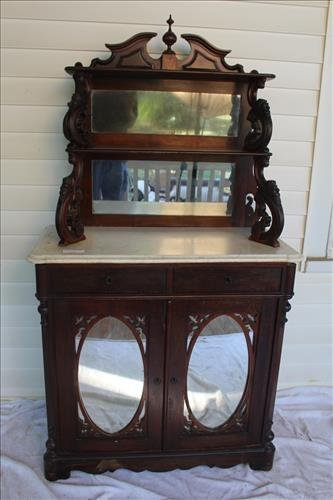 Walnut Victorian etagere with carved supports