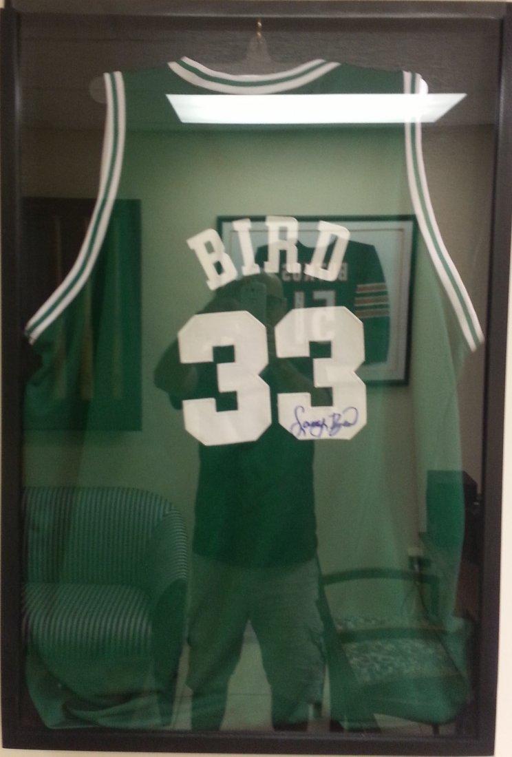 Larry Bird framed in case signed Jersey