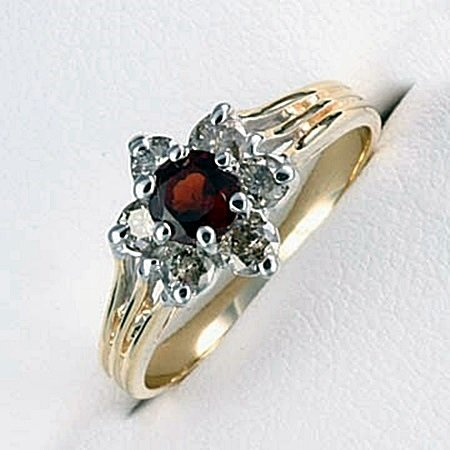 Very Stylish Lady's 10kt Diamond & Garnet Ring