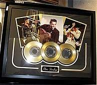 Portrait Of Elvis Presley  with 3 Gold Albums